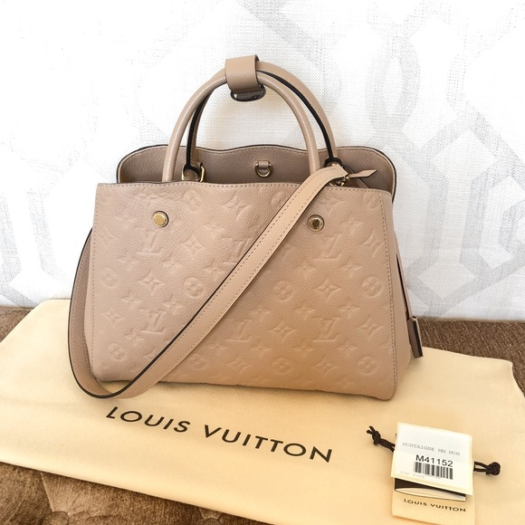 efaefbaed41d0 Louis Vuitton Handbags - Louis Vuitton Montaigne MM Empreinte Dune Handbag